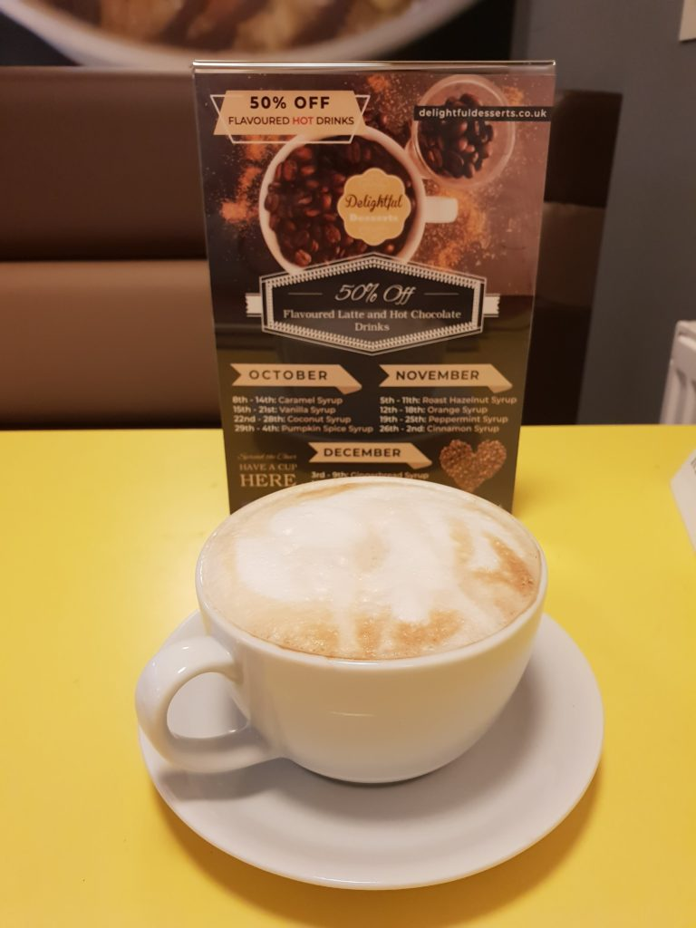 flavoured coffee in front of leaflet